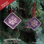 Snowflake ornaments - cast bronze w/red velvet drawstring bag.