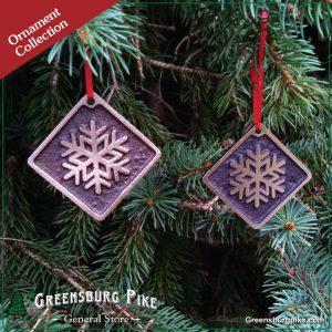 Snowflake ornaments - cast bronze w/red velvet drawstring bag.