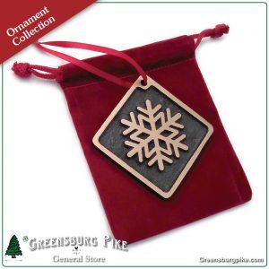 Snowflake ornament - brushed satin finish cast bronze w/red velvet drawstring bag. Made in USA.