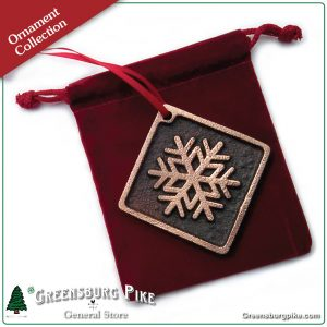 Snowflake ornament - natural rubbed finish cast bronze w/red velvet drawstring bag. Made in USA.